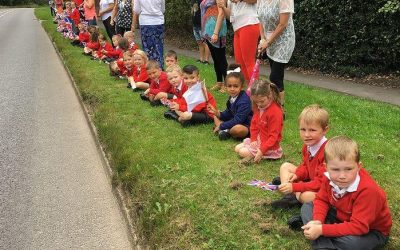 Children from Cranberry Academy cheer on Tour of Britain cyclists